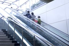 Escalator. Movement of people on the escalator Royalty Free Stock Photo