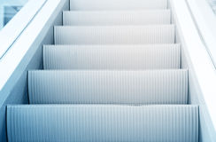 Escalator. Clean beautiful blue escalator way up concept Stock Image