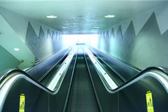 Escalator. A bright blue Escalator going up Stock Photos