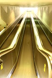 Escalator. A bright gold colored Escalator Royalty Free Stock Images