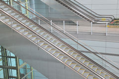 Escalator in airport. Modern electrical escalator in airport Royalty Free Stock Photography