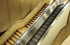 Escalator in airport. Modern electrical escalator in airport Stock Image