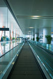 Escalator in airport terminal. Moving escalator in the modern airport terminal Royalty Free Stock Photography