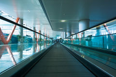 Escalator in airport terminal. Moving escalator in the modern airport terminal Royalty Free Stock Photos