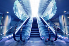 Escalator in airport terminal. No people on moving staircase Royalty Free Stock Photography