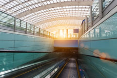 Escalator within the airport. Escalator within the terminal and roof of the transparent in modern airport Royalty Free Stock Images