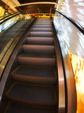Escalator in the big shopping center in the movement Stock Image