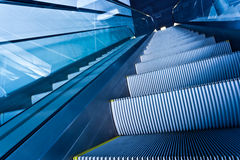 Escalator in blue corridor Stock Image