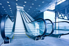 Escalator in blue corridor Royalty Free Stock Photo