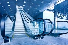 Escalator in blue corridor Royalty Free Stock Photo