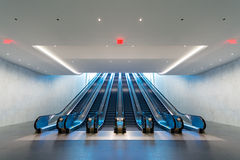 Escalator with blue light coming from upstairs Royalty Free Stock Images