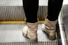 Escalator Boots Girl Royalty Free Stock Images