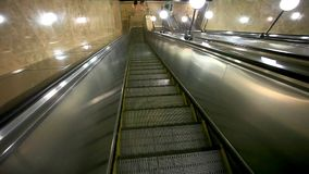 Escalator carries commuters down to the metro stock footage