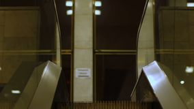 Escalator carrying people between floors at shopping mall, transport device. Stock footage stock footage