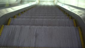 Escalator close up. Escalator steps. Moving steps of the escalator close up. Detailed close-up of running escalators stairs in the airport station stock footage