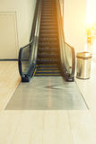 An escalator in department store with sunshine. Stock Image