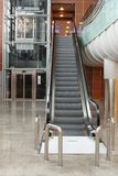 Escalator with elevator at the airport Stock Images