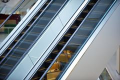 Escalator and empty modern shopping mall interior.  Stock Image