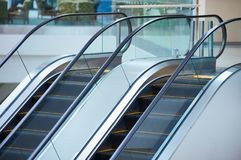 Escalator and empty modern shopping mall interior.  Royalty Free Stock Photo