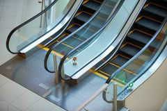 Escalator and empty modern shopping mall interior Stock Photos