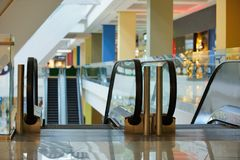 Escalator and empty modern shopping mall interior.  Stock Photography