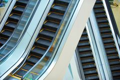 Escalator and empty modern shopping mall interior Royalty Free Stock Photos