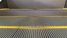 Escalator. Empty moving escalator steps LOOP stock footage
