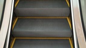 Escalator. Empty moving escalator steps LOOP stock video