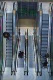 Escalator. Top view with people coming up or going down Royalty Free Stock Photography
