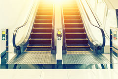 Escalator. Black and metallic color in shopping mall Royalty Free Stock Photography