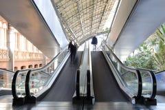 Escalator with a few peolple. Escalator with a few blured peolple Stock Image