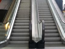 Escalator in font of the mall. In fontt outside the mall Royalty Free Stock Image