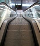 Escalator going down Royalty Free Stock Photos
