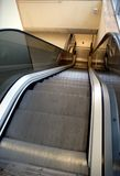 Escalator going down. A escalator in a modern shopping centre in England Royalty Free Stock Photos