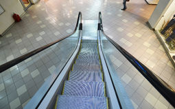 Escalator going down at mall Royalty Free Stock Photography