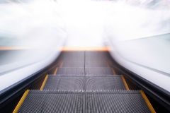 Escalator going down / motion blur Stock Photography