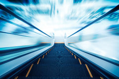 Escalator going down / motion blur Royalty Free Stock Photo