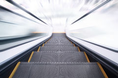Escalator going down / motion blur Stock Image
