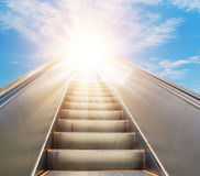 Escalator going forward fading into the sky Stock Images
