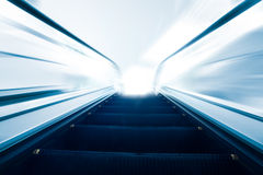 Escalator going up / motion blur Stock Images