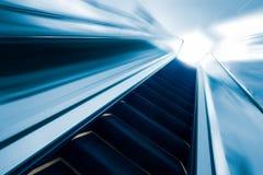 Escalator going up / motion blur Royalty Free Stock Image