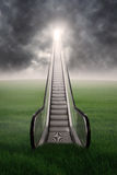Escalator on green field with cloudscape. A staircase to the sky on green field with cloudscape Royalty Free Stock Image