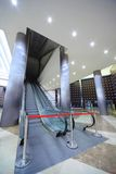 Escalator in hall which is closed barrier Stock Photo