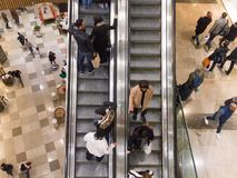 Escalator inside a shopping centre. View of people on an escalator inside a shopping centre stock photos