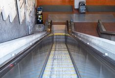 Escalator leading down into a subway tunnel in the daytime royalty free stock images