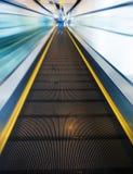 The escalator leading forward to next floor Royalty Free Stock Photography