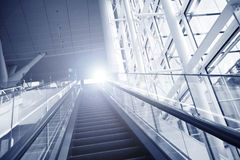 Escalator leading to light. Royalty Free Stock Photo