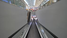 Escalator in mall first person view. Escalator for scroll down to the floor of a shopping mall. Escalator in mall first person view. Escalator for scroll down stock video