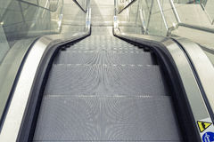 Escalator in a mall. Glass and metal Royalty Free Stock Photos