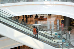 Escalator in mall. Shopping people using escalator Tianjin Joy City China photoed in march 2013 Royalty Free Stock Photos